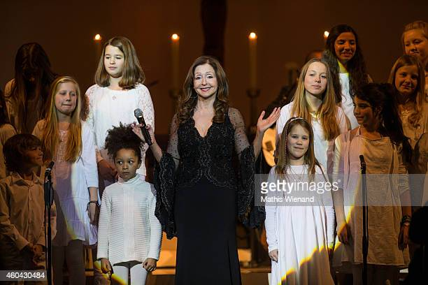 Vicky Leandros and kids perform during the concert tour 'Christmas With Vicky Leandros' at Johannes Church on December 13 2014 in Duesseldorf Germany