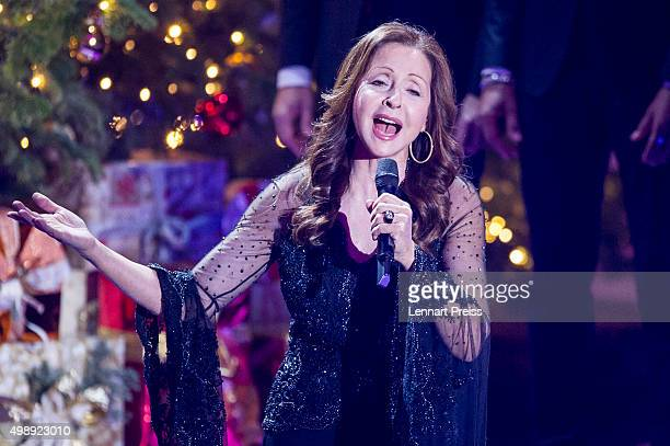 Vicky Leandros performs during the 'Heiligabend mit Carmen Nebel' TV show at Bavaria Filmstudios on November 26 2015 in Munich Germany