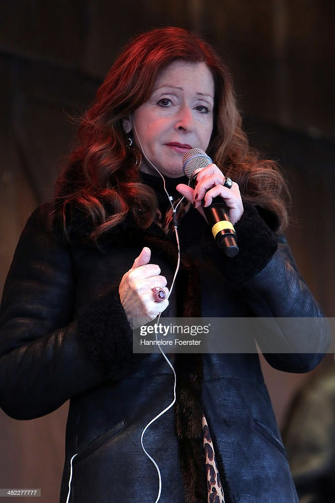 <a gi-track='captionPersonalityLinkClicked' href=/galleries/search?phrase=Vicky+Leandros&family=editorial&specificpeople=652595 ng-click='$event.stopPropagation()'>Vicky Leandros</a> sings at the Christmas market at Roemerberg square on its opening day on November 27, 2013 in Frankfurt, Germany. Christmas markets, which traditionally sell mulled wine, stollen cake, Christmas tree ornaments and other crafts and are an essential part of German Christmas tradition, open across the country this week.
