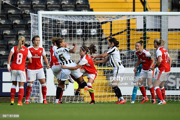 Vicky Losada of Arsenal and Fern Whelan of Notts County tussle for the ball during the match between Notts County Ladies FC and Arsenal Ladies FC on...