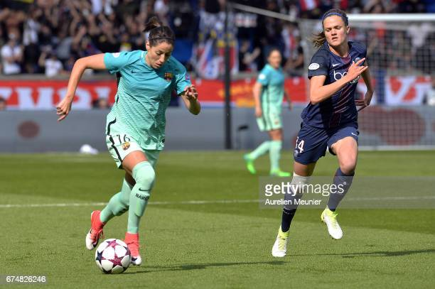 Vicky Losada of Barcelona and Irene Paredes of Paris SaintGermain fight for the ball during the Women's Champions League match between Paris Saint...