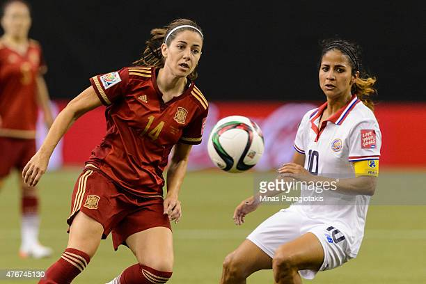 Vicky Losada of Spain and Shirley Cruz of Costa Rica watch the ball during the 2015 FIFA Women's World Cup Group E match at Olympic Stadium on June 9...