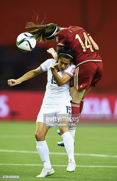 Vicky Losada of Spain is challenged by Cristin Granados of Costa Rica during the FIFA Women's World Cup 2015 group E match between Spain and Costa...