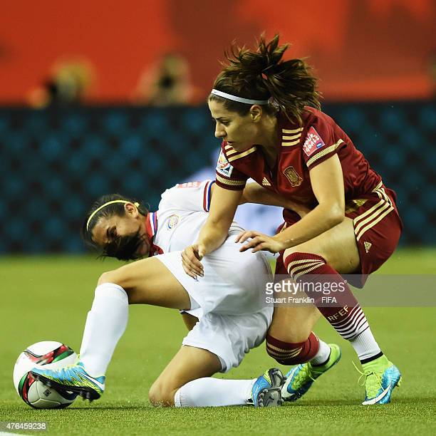 Vicky Losada of Spain is challenged by Lixy Rodriguez of Costa Rica during the FIFA Women's World Cup 2015 group E match between Spain and Costa Rica...