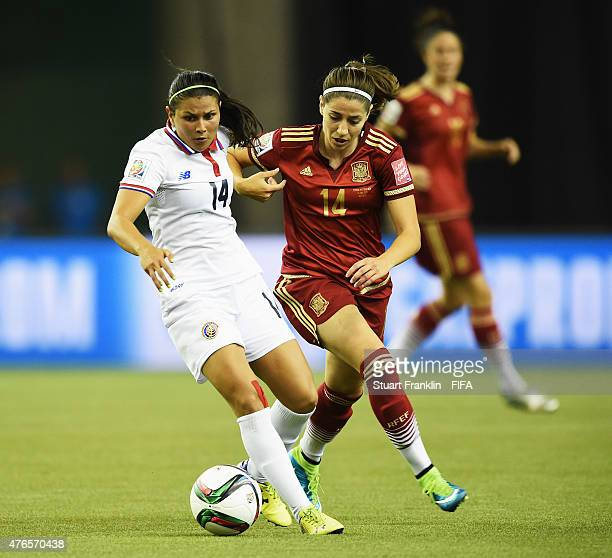 Vicky Losada of Spain is challenged by Maria Barrantes of Costa Rica during the FIFA Women's World Cup 2015 group E match between Spain and Costa...