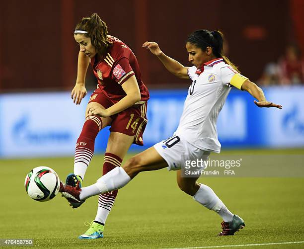 Vicky Losada of Spain is challenged by Shirley Cruz of Costa Rica during the FIFA Women's World Cup 2015 group E match between Spain and Costa Rica...