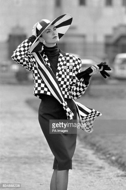 Vicky models a black and white chequered jacket and black figure hugging skirt from London launch of Lois Feraud's collection