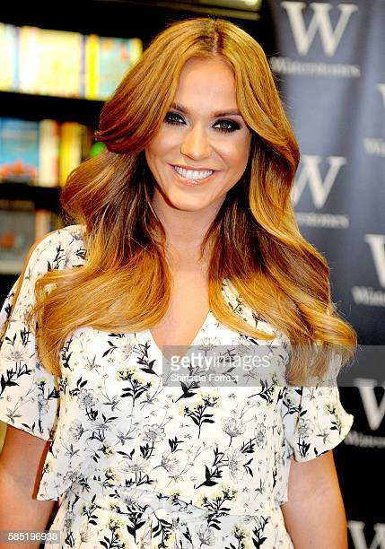 Vicky Pattison signs copies of her book 'The Real Me Fashion Fitness And Food Tips For Real Women' at Waterstones Trafford Centre on August 2 2016 in...