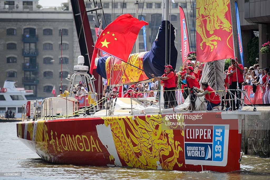 Vicky Song Kun of the Qingdao crew waves the Chinese flag in Saint Katherine's Dock in London, England after becoming the first Chinese woman to sail around the world, while also completing the 2013-14 Clipper Round the World Yacht Race, on July 12, 2014. The world's longest ocean race began on September 1, 2013, with a 12-strong fleet visiting 14 ports on six continents and travelling 40,000 miles before returning to the British capital. AFP PHOTO/Leon Neal