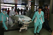 A victim of a knife attack is seen at hospital on November 27 2014 in Nanning Guangxi province of China A 26yearold man from Nanning attacked a...