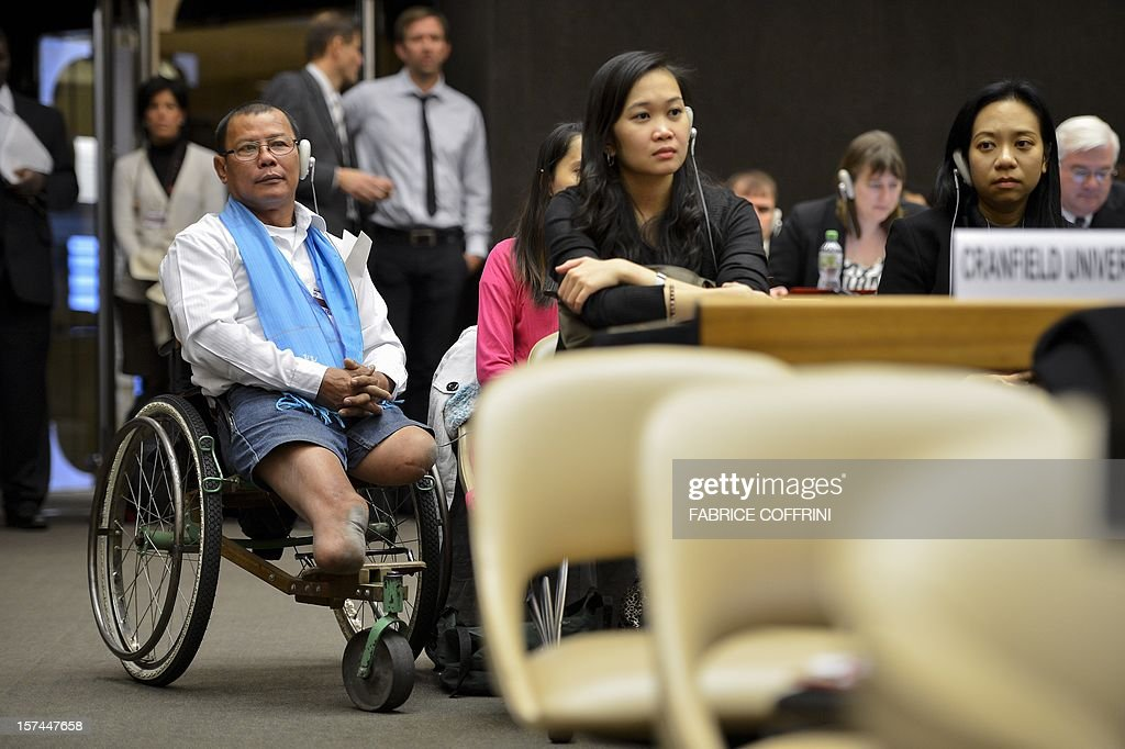 Victim of a landmine Cambodian Tun Chan Nareth attends the opening day of the 12th assembly of countries party to the international Ottawa Treaty banning the use of landmines on December 3, 2012 at the United Nations offices in Geneva. AFP PHOTO / FABRICE COFFRINI