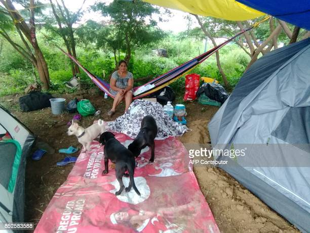 A victim of the 61magnitude earthquake rests in a temporary countryside shelter in Ixtlatepec Oaxaca state Mexico on September 23 2017 Efforts to...