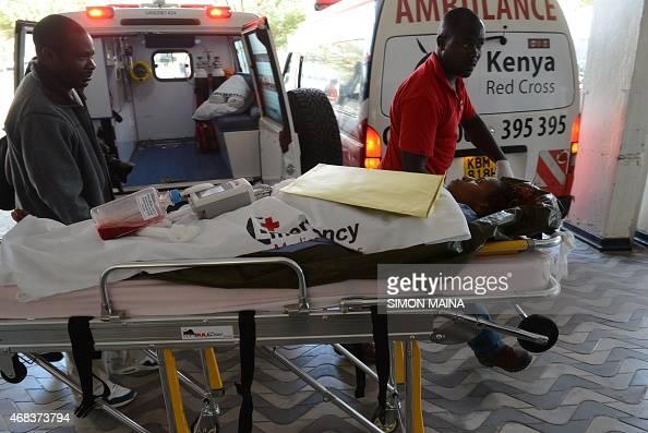 A victim of the attack on a Kenyan university Garissa University College is wheeled into the Kenyatta hospital on April 2 2015 in Nairobi AlShebab...