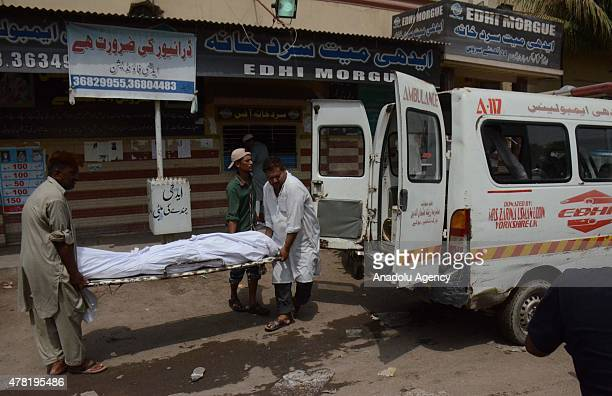 A victim of the heatwave is taken to mortuary of Edhi Centre in Karachi on June 23 2015 The death toll from a threeday long sweltering heat wave has...
