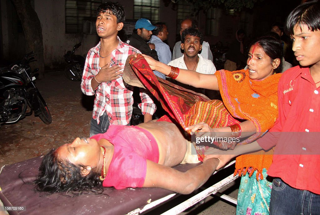A victim of the stampede is rushed to hospital after a bamboo bridge collapsed during Chhat Puja on the banks of the Ganges River in Patna on November 19, 2012. At least 18 people were killed and more than a dozen injured in a stampede on Monday during a Hindu festival in the eastern Indian city of Patna, a senior police officer said. Kant said the stampede occurred when a makeshift bridge on the Ganges river gave way under the weight of Hindu devotees rushing to offer prayers to the setting sun as part of an annual Hindu religious ritual. AFP PHOTO/Ranjin Rahi