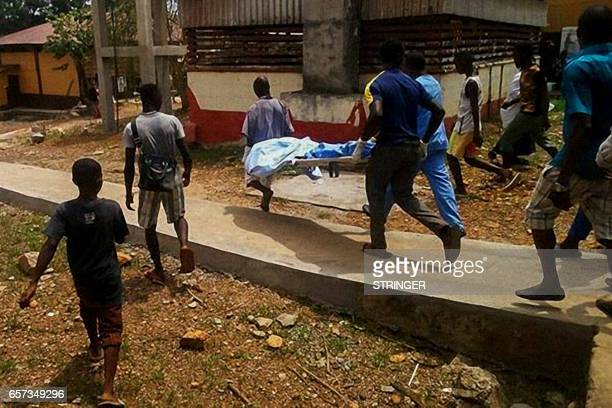 A victim of the unrest in the southern city of Bo is rushed to the local hospital on March 24 2017 A student has been killed and several others...