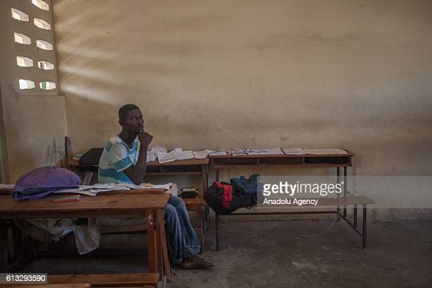 A victim who lost his house due to hurricane Matthew sits in a classroom at a school which is being used as a shelter in town of Les Cayes in Haiti...
