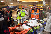 Victims are given medical assistance at Casino Du Palais De La Mediterranee following a truck attack on Promenade des Anglais on July 14 2016 in Nice...