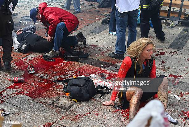 Victims are in shock and being treated at the scene of the first explosion that went off near the finish line of the Boston Marathon