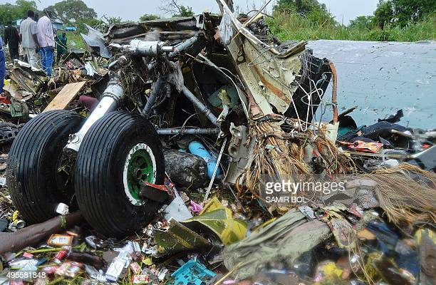 Victims' bodies are pictured under the landing gear at the site where a cargo plane crashed into a small farming community on a small island in the...