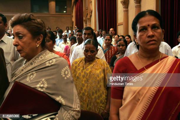 Victims family Ashok Kamte's mother Tukaram Ombale's wife and Major Sandeep Unikrishnan's mother at distribution CNG agency held at Shayadhri guest...