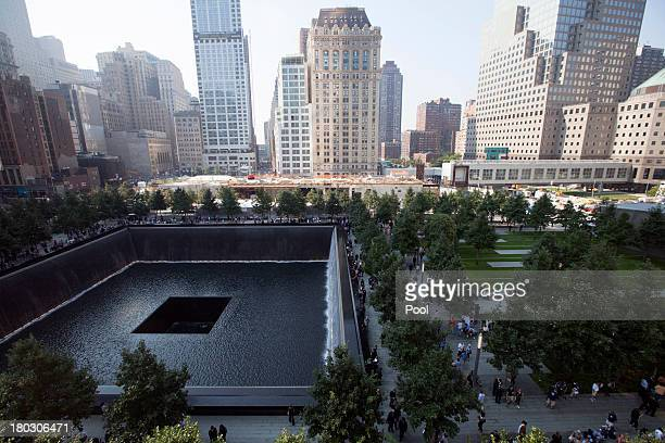 Victims family members view names along the south reflecting pool at the 9/11 Memorial during ceremonies for the 12th anniversary of the terrorist...