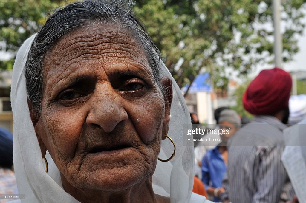 Victims of 1984 Sikh riots with tearful eyes after the court acquitted congress leader Sajjan Kumar lack of evidence at karkardhoma court on April 30, 2013 in New Delhi, India. Congress leader Sajjan Kumar has been acquitted by a special CBI court of all charges in one of three 1984 anti-Sikh riots cases against him. Kumar, a former Lok Sabha MP from Outer Delhi, still faces trial in another 1984 rioting case. In a third case, Delhi Police has filed a closure report, saying there was no evidence against Kumar to implicate him. The 1984 anti-Sikh riots broke out after the assassination of the then Prime Minister Indira Gandhi on October 31, 1984.