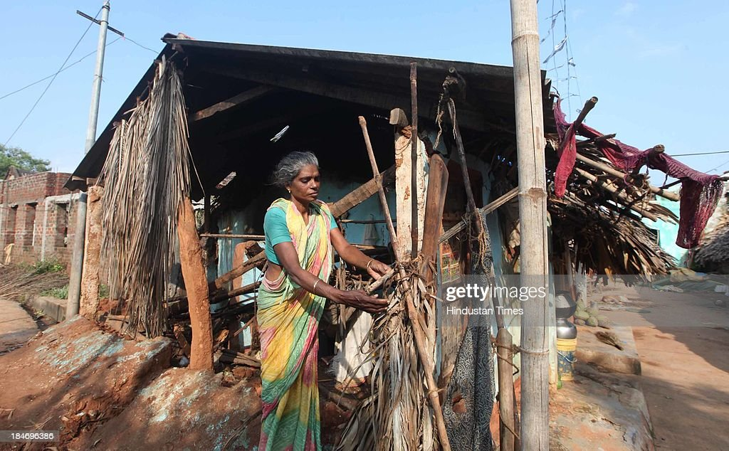 Victims of cyclone Phailin trying to restore their homes at Talatampara village on October 14, 2013 in Srikakulam, India. Cyclone Phailin on Sunday left a trail of destruction knocking down lakhs of homes affecting nearly 90 lakh people and destroying paddy crops worth about Rs 2,400 crore, but Odisha and Andhra Pradesh escaped from widespread loss of life due to timely and efficient evacuation efforts .
