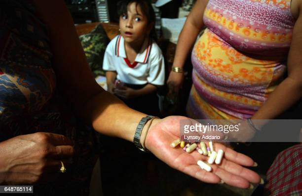 Victims of 'Doctor' Miriam Yukkei Gaona or the 'Beauty Killer' hold out a variety of pills they had been prescribed illegally by the impersonator at...