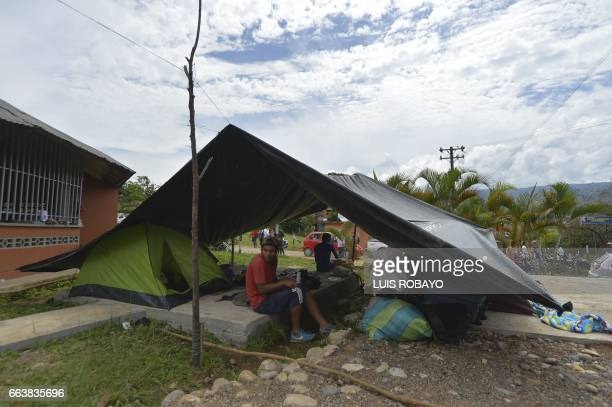 Victims of mudslides wait for aid in a shelter in Mocoa Putumayo department southern Colombia on April 2 2017 The death toll from a devastating...