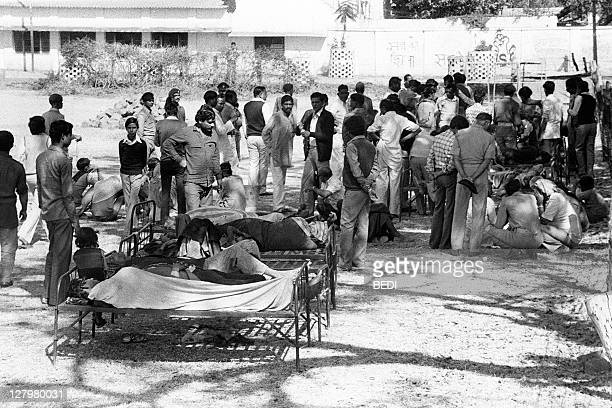 Victims of the Bhopal tragedy wait to be treated on December 04 1984 at Bhopal's hospital where a poison gas leak from the Union Carbide factory...