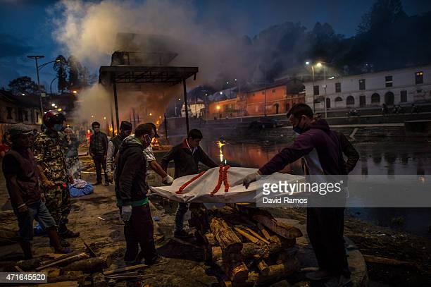 Victims of the earthquake are cremated at Pashupatinah Temple on April 30 2015 in Kathmandu Nepal A major 78 earthquake hit Kathmandu midday on...