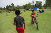Victims of the earthquake play cricket at a makeshift camp set up on a golf course on April 30 2015 in Kathmandu Nepal A major 78 earthquake hit...