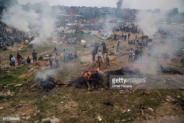 Victims of the earthquake that hit Nepal yesterday are cremated on April 26 2015 in Bhaktapur Nepal A major 78 earthquake hit Kathmandu midday on...