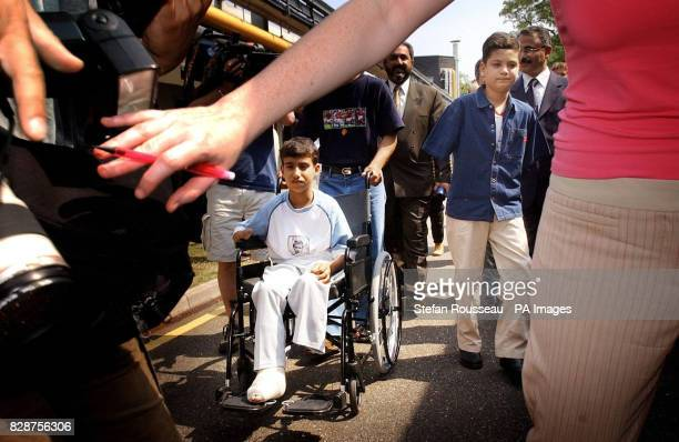 Victims of the war in Iraq 14yearold Ahmad Mohammed Hamza and Ali Ismaeel Abbas as they arrive at Queen Mary's Hospital Roehampton in south London...