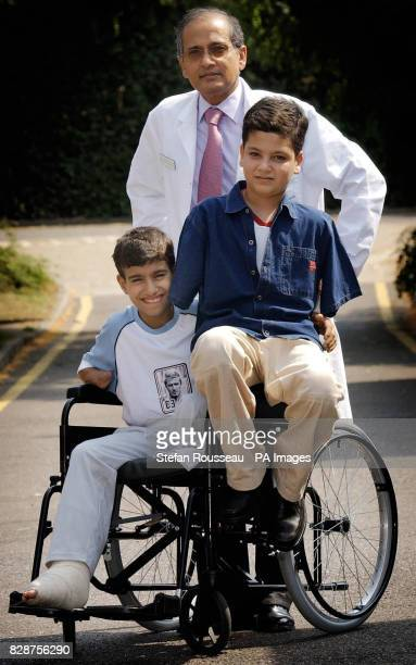 Victims of the war in Iraq fourteenyearold Ahmad Mohammed Hamza and Ali Ismaeel Abbas with Dr Sellaiah Sooriakumaran as they arrive at Queen Mary's...
