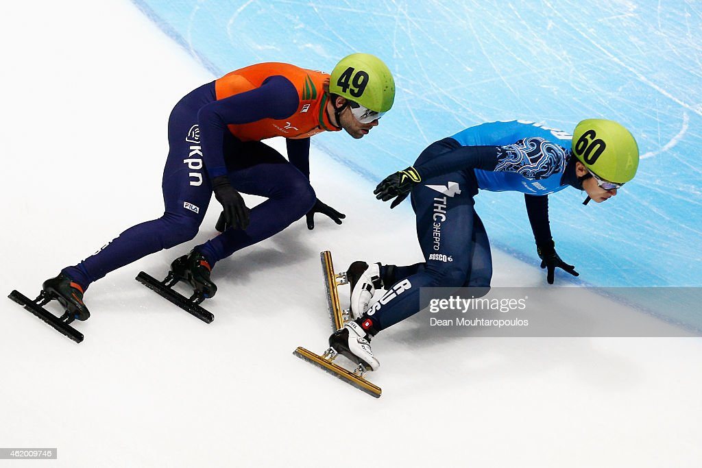 Victor An of Russia and #49 <a gi-track='captionPersonalityLinkClicked' href=/galleries/search?phrase=Daan+Breeuwsma&family=editorial&specificpeople=5579058 ng-click='$event.stopPropagation()'>Daan Breeuwsma</a> of the Netherlands compete in the Mens 500m Heats during day 1 of the ISU European Short Track Speed Skating Championships at The Sportboulevard on January 23, 2015 in Dordrecht, Netherlands.