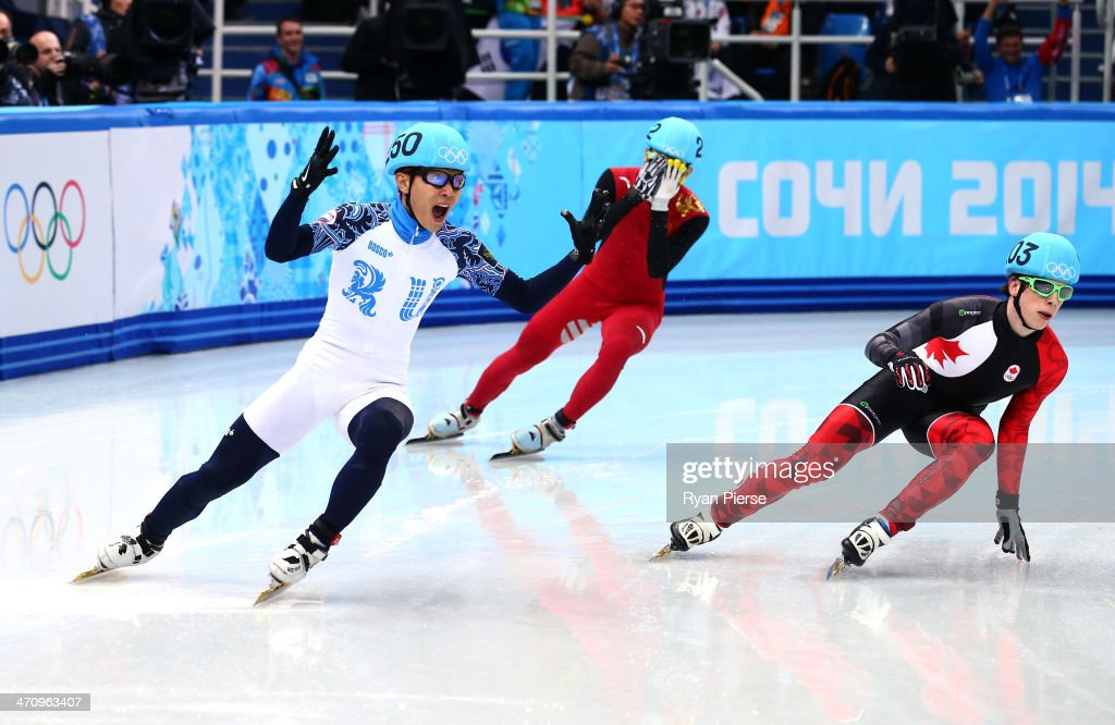 Victor An (L) of Russia celebrates winning the gold medal in the Short Track Men's 500m Final A on day fourteen of the 2014 Sochi Winter Olympics at Iceberg Skating Palace on February 21, 2014 in Sochi, Russia.
