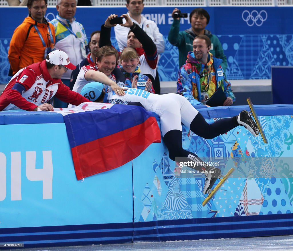 Victor An (L) of Russia celebrates winning the gold medal with his coach in the Short Track Men's 500m Final A on day fourteen of the 2014 Sochi Winter Olympics at Iceberg Skating Palace on February 21, 2014 in Sochi, Russia.