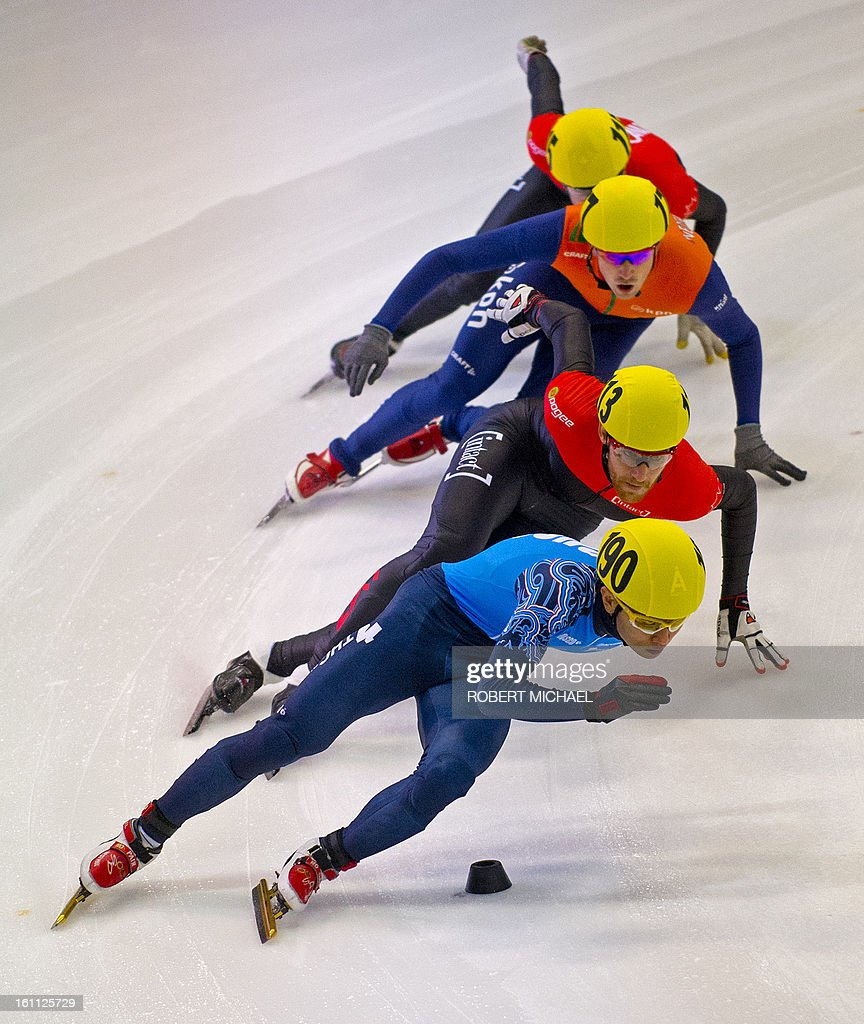 Victor An of Russia leads the pack at the men's 1000m semi final race of the ISU World Cup short track speed skating event in Dresden, eastern Germany, on February 9, 2013.