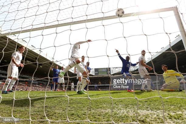Victor Anichebe of Everton celebrates as Phil Jagielka of Everton scores their first goal during the Barclays Premier League match between Tottenham...