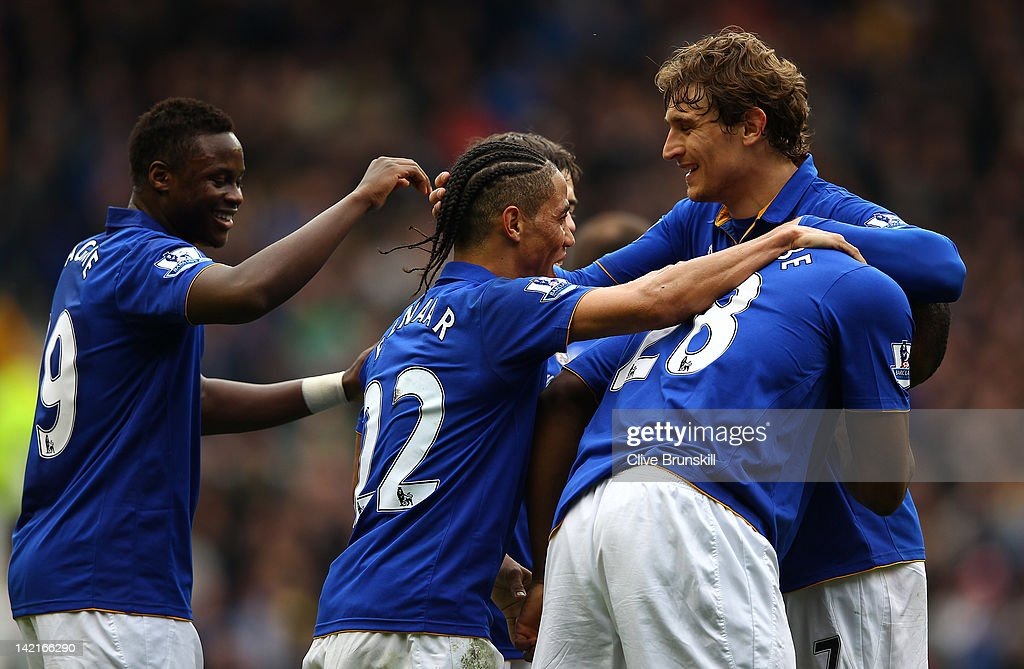 <a gi-track='captionPersonalityLinkClicked' href=/galleries/search?phrase=Victor+Anichebe&family=editorial&specificpeople=740464 ng-click='$event.stopPropagation()'>Victor Anichebe</a> of Everton is congratulated by team mates <a gi-track='captionPersonalityLinkClicked' href=/galleries/search?phrase=Nikica+Jelavic&family=editorial&specificpeople=5986831 ng-click='$event.stopPropagation()'>Nikica Jelavic</a>,<a gi-track='captionPersonalityLinkClicked' href=/galleries/search?phrase=Steven+Pienaar&family=editorial&specificpeople=787271 ng-click='$event.stopPropagation()'>Steven Pienaar</a> and <a gi-track='captionPersonalityLinkClicked' href=/galleries/search?phrase=Magaye+Gueye&family=editorial&specificpeople=7018117 ng-click='$event.stopPropagation()'>Magaye Gueye</a> after scoring the second goal during the Barclays Premier League match between Everton and West Bromwich Albion at Goodison Park on March 31, 2012 in Liverpool, England.