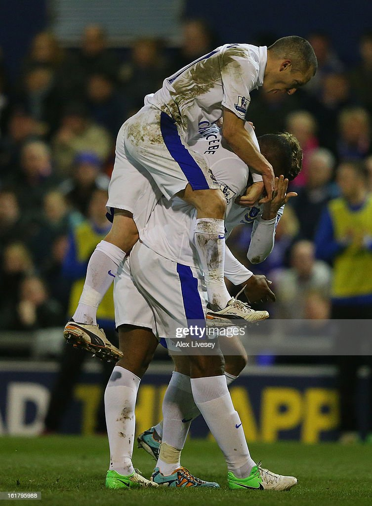 Victor Anichebe of Everton is mobbed by his team-mates after scoring his team's first goal to make the score 1-1 during the FA Cup with Budweiser Fifth Round match between Oldham Athletic and Everton at Boundary Park on February 16, 2013 in Oldham, England.