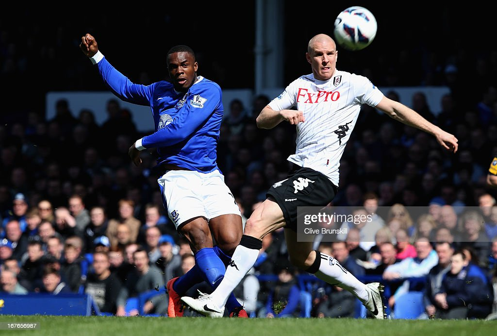 <a gi-track='captionPersonalityLinkClicked' href=/galleries/search?phrase=Victor+Anichebe&family=editorial&specificpeople=740464 ng-click='$event.stopPropagation()'>Victor Anichebe</a> of Everton shoots past <a gi-track='captionPersonalityLinkClicked' href=/galleries/search?phrase=Philippe+Senderos&family=editorial&specificpeople=221471 ng-click='$event.stopPropagation()'>Philippe Senderos</a> of Fulham during the Barclays Premier League match between Everton and Fulham at Goodison Park on April 27, 2013 in Liverpool, England.