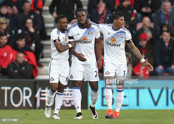 Victor Anichebe of Sunderland celebrates scoring his sides first goal with Jermain Defoe of Sunderland and Patrick van Aanholt of Sunderland during...