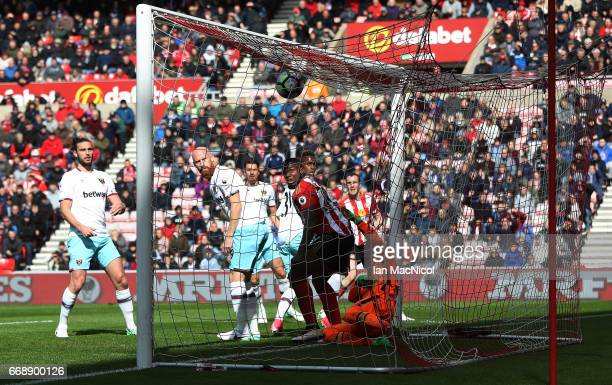 Victor Anichebe of Sunderland challenges Darren Randolph of West Ham United as Wahbi Khazri of Sunderland scores his sides first goal during the...