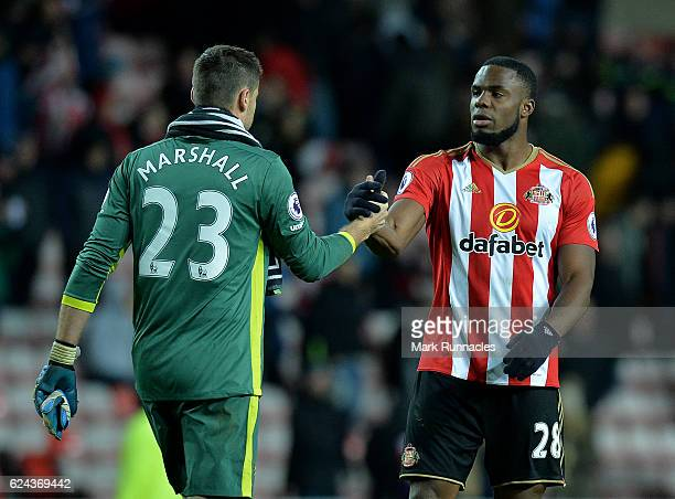 Victor Anichebe of Sunderland shakes hands with David Marshall of Hull City at the final whistle during the Premier League match between Sunderland...
