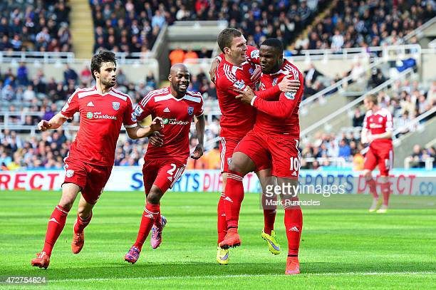 Victor Anichebe of West Brom celebrates scoring the opening goal with team mates during the Barclays Premier League match between Newcastle United...