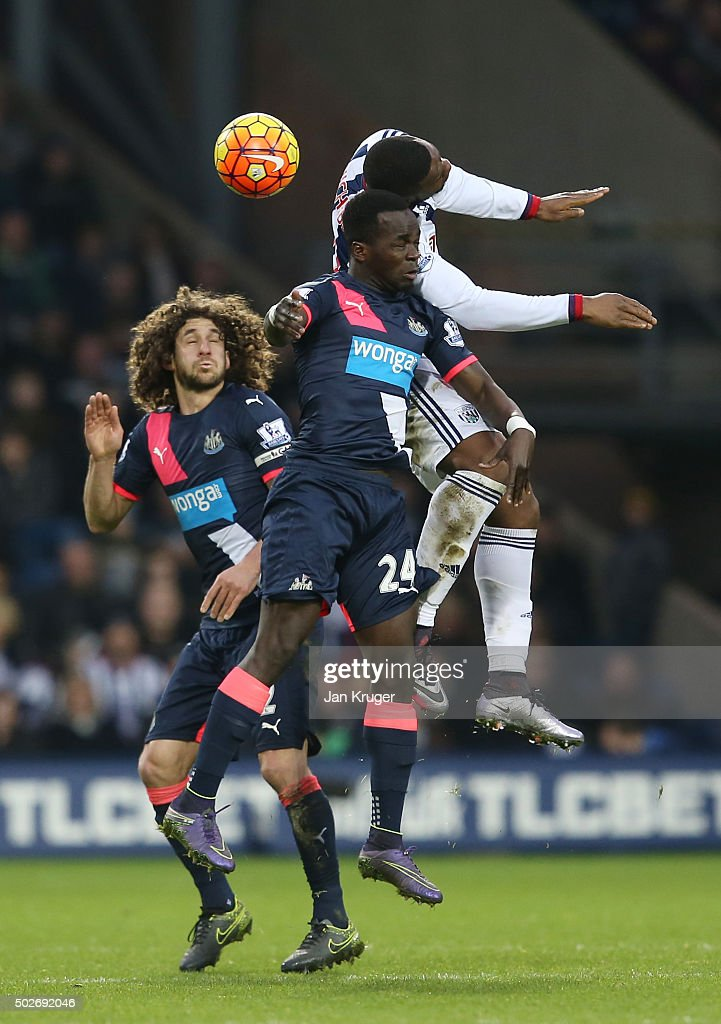 Victor Anichebe of West Bromwich Albion and Cheik Ismael Tiote of Newcastle United compete for the ball during the Barclays Premier League match between West Bromwich Albion and Newcastle United at The Hawthorns on December 28, 2015 in West Bromwich, England.