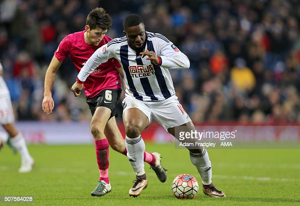 Victor Anichebe of West Bromwich Albion and Jack Baldwin of Peterborough United during the Emirates FA Cup match between West Bromwich Albion and...